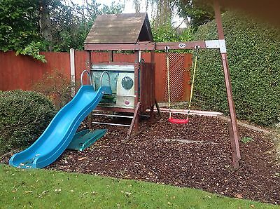 Child's slide and swing with playhouse