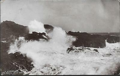 Lunan Bay, Angus - Rocks, stormy sea - Davidson real photo postcard 1915