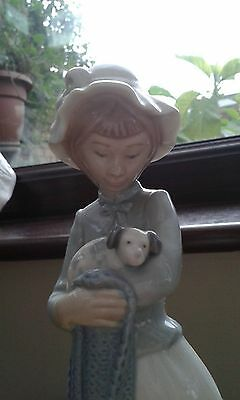 Lovely Nao/lladro lady holding a puppy figurine