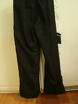 Boy's Youth Nike black sweat pants with side zippers Size Large