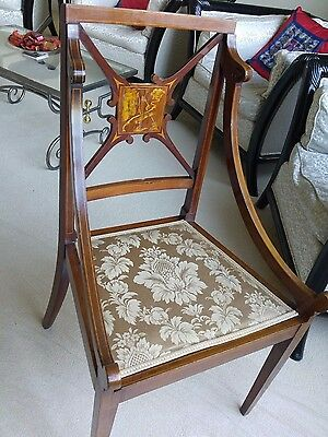Antique chair with inlaid back