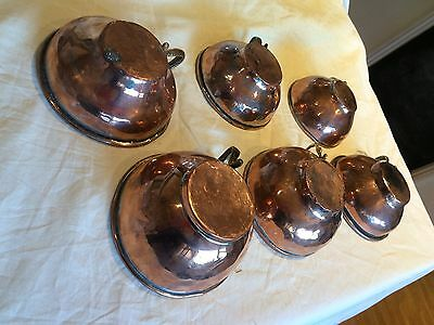 old copper cups