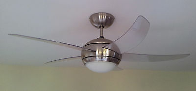 Manhattan remote control ceiling fan with light. Chrome with clear blades.