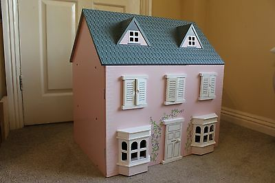 Pink Wooden Dolls House with 13 pieces furniture and 4 Dolls