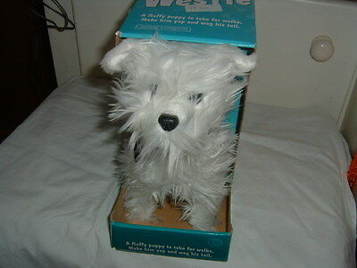 toy  walking  westie  dog   it  yaps  and  and  wags  tail