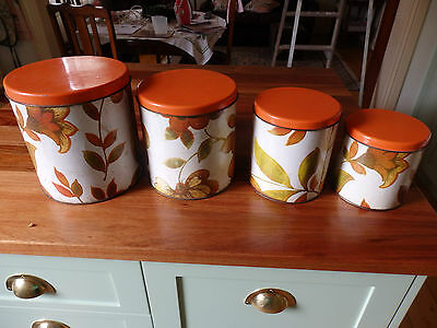 """Retro """" Willow """" 4 Piece Canister Set. Floral Pattern with Orange Lids"""