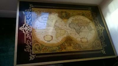Vintage wooden coffee table with world map glass top
