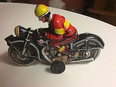 Vintage JW Joseph Wagner tinplate friction motorcycle and rider, Western Germany
