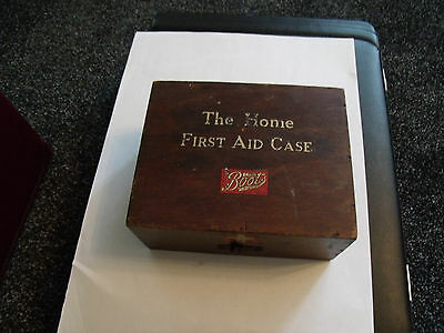 vintage wooden first aid box and products.