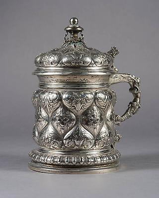 A 19th Century German Solid Silver & Gold Wash Embossed Tankard
