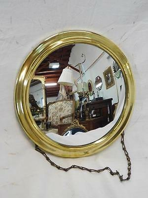 A Delightful Antique Brass Porthole Convex Wall Mirror