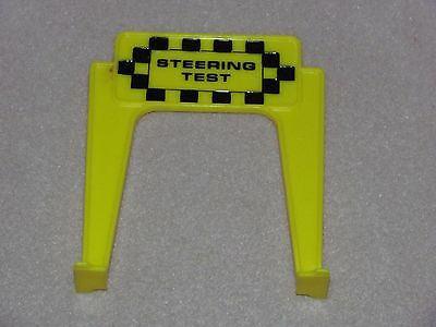 """(1) 1965 Ideal Motorific Torture Track """"Spring Test"""" yellow sign, CM-7788"""