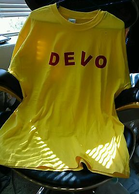 DEVO Yellow XL T-shirt with red letters vintage never warn.