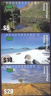 *PHONECARDS.USED.LANDSCAPES.SET of THREE.One hole.*