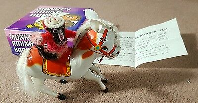 MONKEY RIDING HORSE CLOCKWORK METAL TOY - THE CURE STRANGE ATTRACTION Cover 1996