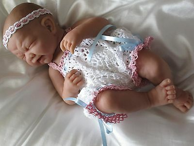 """Berenguer Baby doll First Tear 14"""" with romper and headband all vinyl."""