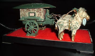 Horse drawn casket carrier