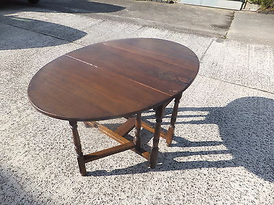 Antique oak gate leg oval table and 2 chairs