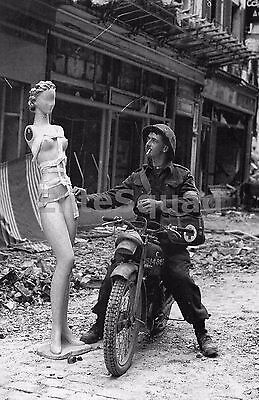 WW2 Picture A Canadian dispatch rider in Normandy strikes mannequin's hip 685