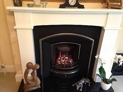 gas fire ,wood surround,cast iron back plate and chair brick also spare gas fire