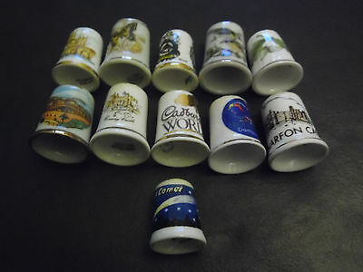A Small Collection Of 11 China Thimbles