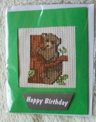 Completed cross stitch card - bear cub in tree