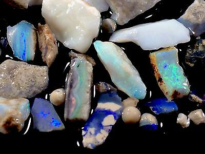 101ct parcel Lightning Ridge Opal Small Gem Rough and brilliant fire chips
