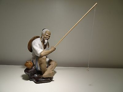 Chinese Shiwan Ceramic figurine of a Fishman with rod