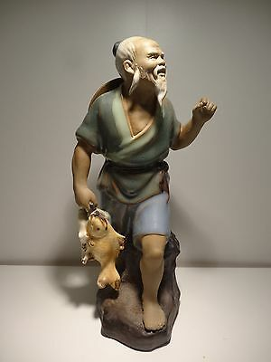 Chinese Shiwan Ceramic figurine of a Fishman with Fishes
