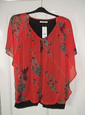 ladies Beautiful top. Orange flowered patterned top, size 24  (new with tags)