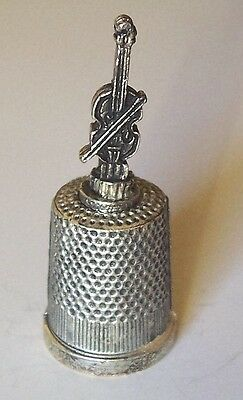 One new METAL THIMBLE with violin - cello on top