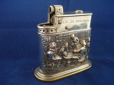 A Myflam Petrol Table Lighter With A Silver Wrap Of A Tavern Scene .