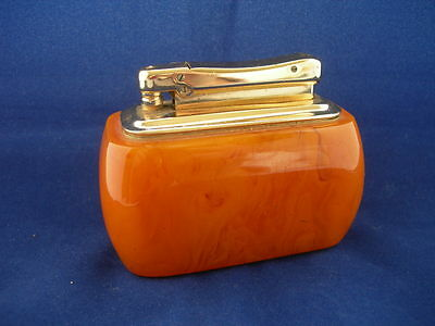 A Colibri Monopol Petrol Table Lighter  With A Catalin Sleeve .