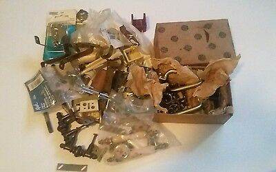 Miscellaneous box of handles and other household pieces and parts