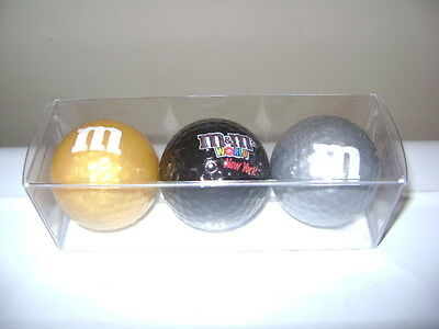 M&M's WORLD NEW YORK m&m GOLF BALL SET. GOLD, BLACK & SILVER. NEW IN PACK.