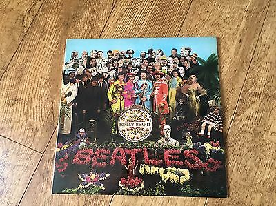 The Beatles Sgt Peppers Lonely Hearts Club Band Mint Condition.