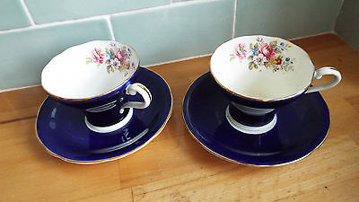 Pair of vintage Aynsley colbart blue & gilt and floral cup and saucers