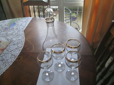 wine decanter with four glasses gold rimmed