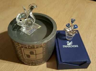 """SWAROVSKI SILVER CRYSTAL  ( SCS) ,, SQUVIREL WITH  NUT and  BLUE FLOWERS """"."""