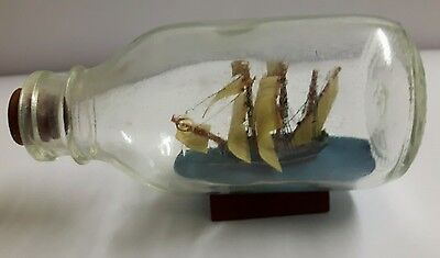 Ship In a Bottle on Wooden Stand