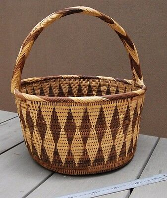 Large old Papua New Guinea woven cane Buka carry basket with handle