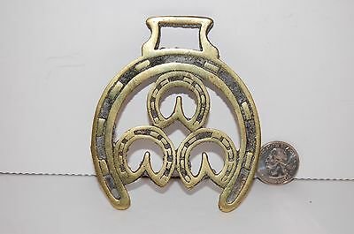 Antique Solid Horse Brass With three horse shoes surrounded by larger horse shoe