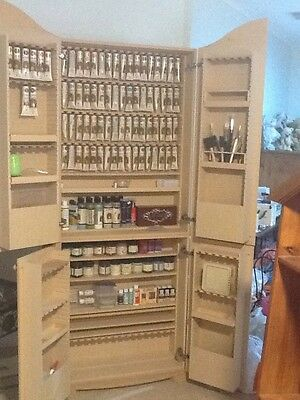 folk art cupboard Filled,paint and brushes
