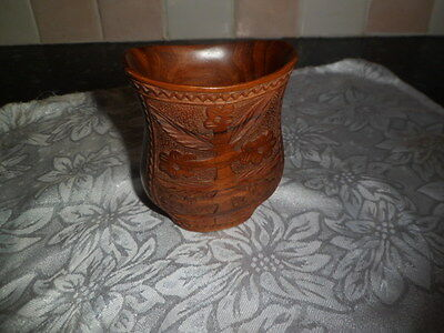 carved wooden vase