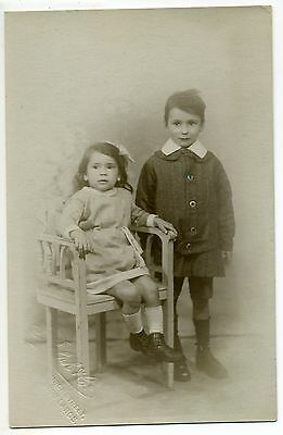 REAL PHOTO YOUNG GIRL and BOY IN  EDWARDIAN DRESS  OLD POSTCARD