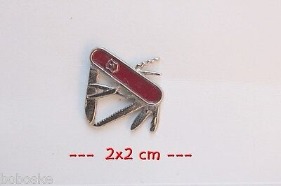 Pin's couteau Suisse
