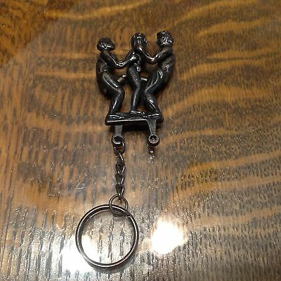 Vintage Rare Naughty Keychain erotic/sex move/mechanize Menache a trois adult