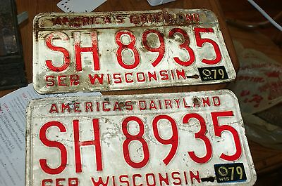 Pair of Wisconsin Red on White Sep 73 plates with 79 sticker