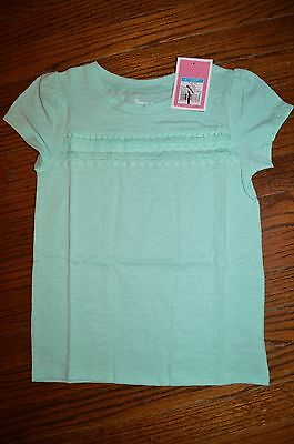 NWT! Circo aqua short sleeve knit top with trim detailing in front - size 6