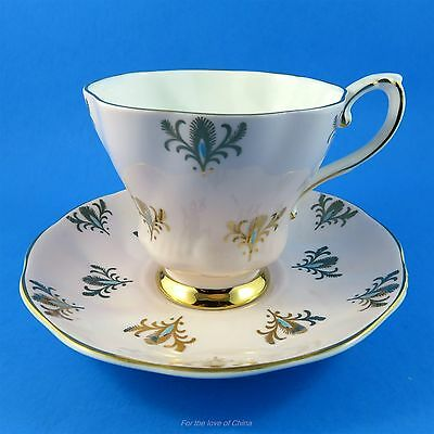 Gold with Blue Design on Pink Royal Grafton Tea Cup and Saucer Set